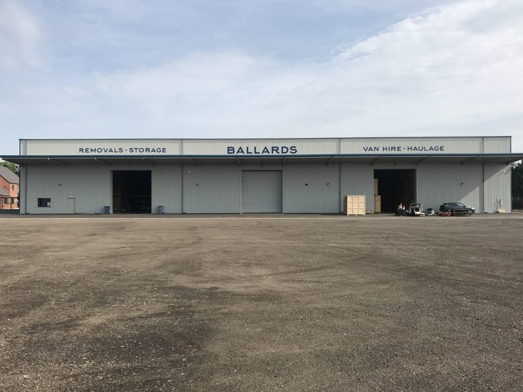 White roller shutters for Ballards Removals & Storage