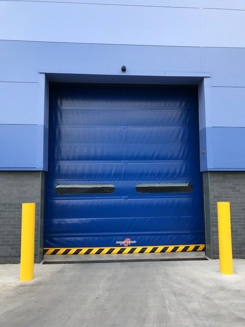 Blue high speed door with 2 peepholes, outside view