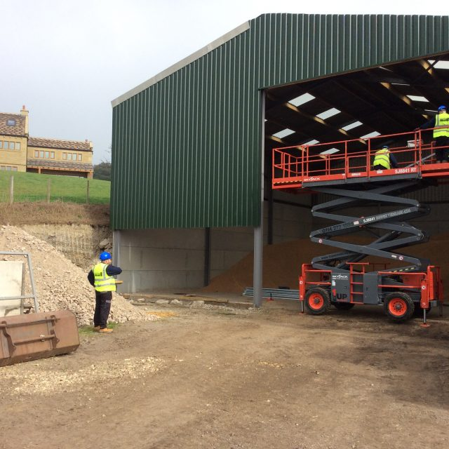 Engineers installing a new shutter for a warehouse
