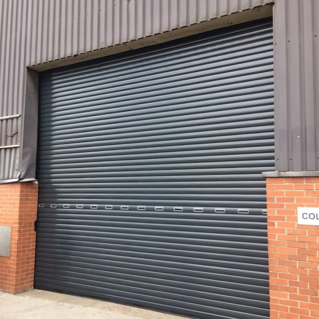 Insulted grey roller shutter with small peepholes